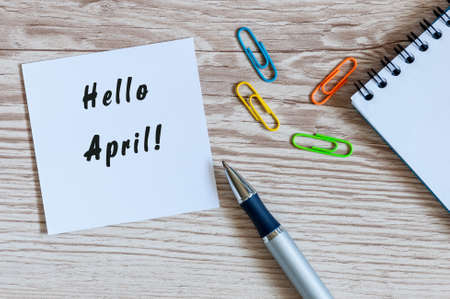 Hello April handwriting notice with office supplies