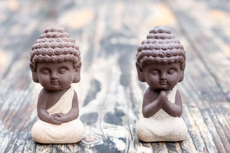 Baby Budda Statues, Teacher or master and apprentice. Two little monks. Meditation and zen, relaxation concept Stok Fotoğraf