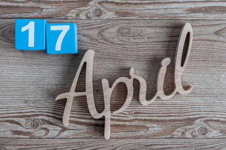 17th: April 17th. Day 17 of month, daily calendar on wooden table. Spring time theme
