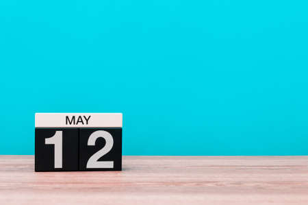 May 12th. Day 12 of month, calendar on turquoise background. Spring time, empty space for text. International Nurses Day