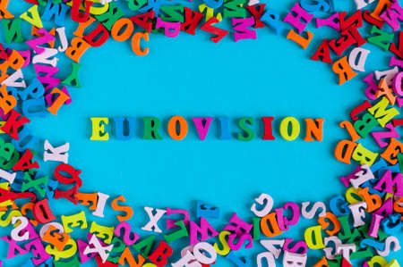 Eurovision - word composed of small colored letters on blue background. 2017 year Stock Photo