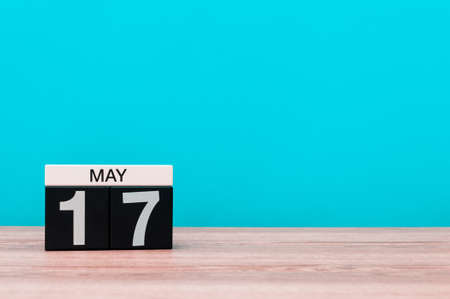 17th: May 17th. Day 17 of month, calendar on turquoise background. Spring time, empty space for text