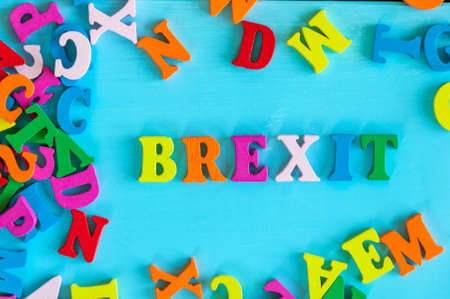 withdrawal: brexit or british exit - word composed of small colored letters on blue background Stock Photo