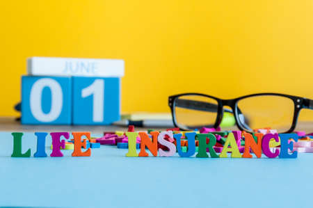 misadventure: Life insurance, family services, supporting concepts. Word composed of small colored letters on business workplace of insurance agent or doctor cabinet.