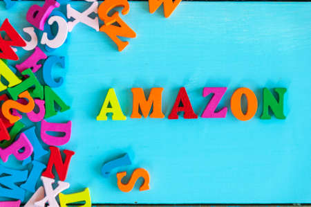 KIEV, UKRAINE - MAY 09, 2017: Amazon - word composed of small colored letters on blue background. Amazon is an American electronic commerce company Editorial