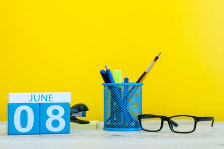 June 8th. Day 8 of month, calendar on yellow background with office suplies. Summer time at work. International Cleanup Day. Stock Photo
