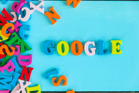KIEV, UKRAINE - MAY 09, 2017: Google - word composed of small colored letters on blue background. Google is USA multinational corporation specializing in Internet-related services Editorial