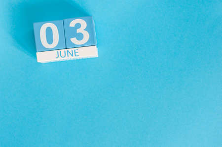 June 3rd. Image of june 3 wooden color calendar on blue background.  Summer day, empty space for text Stock Photo