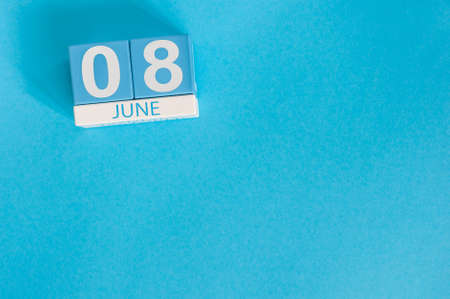 June 8th. Image of june 8 wooden color calendar on blue background. Summer day, empty space for text. International Cleanup Day