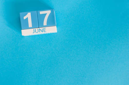 June 17th. Image of june 17 wooden color calendar on blue background. Summer day. Empty space for text Stock Photo