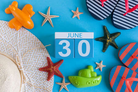 hi hat: June 30th. Image of june 30 calendar on blue background with summer beach, traveler outfit and accessories. Summer time Stock Photo