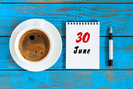 June 30th. Image of june 30 , daily calendar on blue background with morning coffee cup. Summer day, Top view