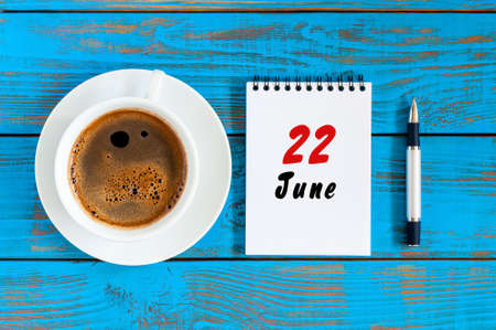 June 22nd. Image of june 22 , daily calendar on blue background with morning coffee cup. Summer day, Top view Stock Photo