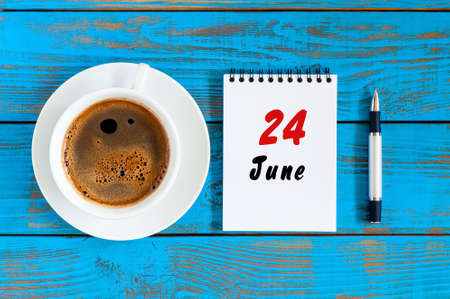 June 24th. Image of june 24 , daily calendar on blue background with morning coffee cup. Summer day, Top view