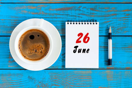June 26th. Image of june 26 , daily calendar on blue background with morning coffee cup. Summer day, Top view Stock Photo