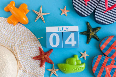 independance: July 4th. Image of july 4 calendar with summer beach accessories and traveler outfit on background. Summer day, Vacation concept Stock Photo