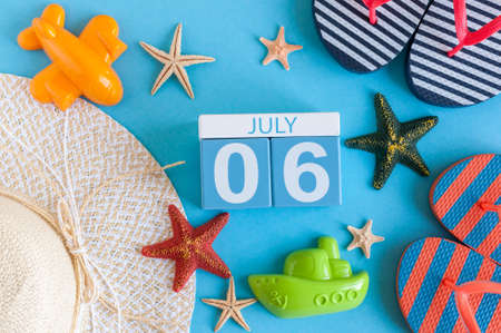 July 6th. Image of july 6 calendar with summer beach accessories and traveler outfit on background. Summer day, Vacation concept