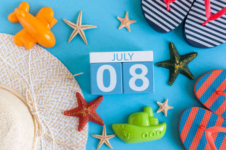 July 8th. Image of july 8 calendar with summer beach accessories and traveler outfit on background. Summer day, Vacation concept Stock Photo