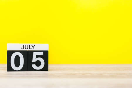 first day: July 5th. Image of july 5, calendar on yellow background. Summer time. With empty space for text
