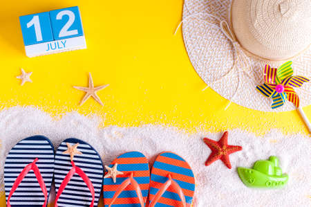 independance: July 12th. Image of july 12 calendar with summer beach accessories and traveler outfit on background. Summer day, Vacation concept