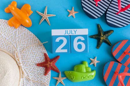 26: July 26th. Image of july 26 calendar with summer beach accessories and traveler outfit on background. Summer day, Vacation concept Stock Photo