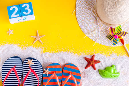 independance: July 23rd. Image of july 23 calendar with summer beach accessories and traveler outfit on background. Summer day, Vacation concept
