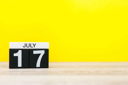 17th: July 17th. Image of july 17, calendar on yellow background. Summer time. With empty space for text