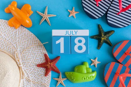 independance: July 18th. Image of july 18 calendar with summer beach accessories and traveler outfit on background. Summer day, Vacation concept