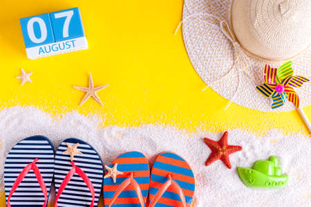 August 7th. Image of august 7 calendar with summer beach accessories and traveler outfit on background. Summer day, Vacation concept