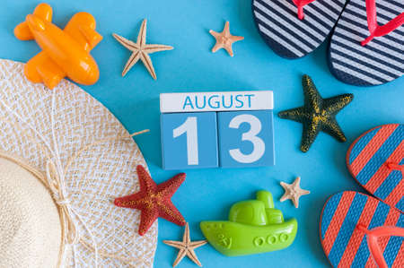 August 13th. Image of August 13 calendar with summer beach accessories and traveler outfit on background. Summer day, Vacation concept