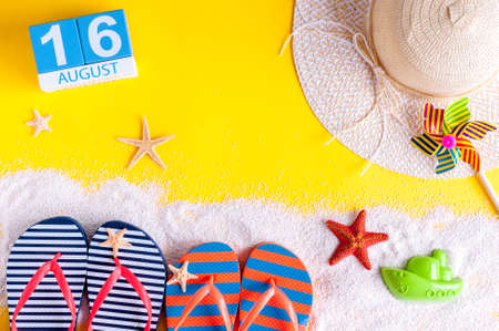 August 16th. Image of august 16 calendar with summer beach accessories and traveler outfit on background. Summer day, Vacation concept