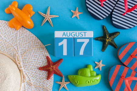 17th: August 17th. Image of August 17 calendar with summer beach accessories and traveler outfit on background. Summer day, Vacation concept