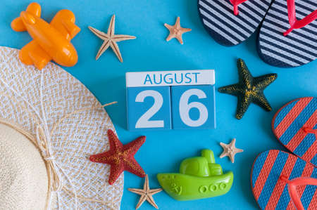 August 26th. Image of August 26 calendar with summer beach accessories and traveler outfit on background. Summer day, Vacation concept. Stock Photo