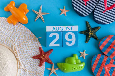 important date: August 29th. Image of August 29 calendar with summer beach accessories and traveler outfit on background. Summer day, Vacation concept Stock Photo