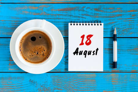 August 18th. Day 18 of month, daily calendar on blue background with morning coffee cup. Summer time. Unique top view. Stock Photo