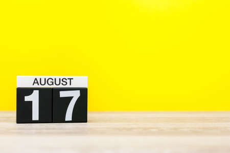 17th: August 17th. Image of august 17, calendar on yellow background with empty space for text. Summer time