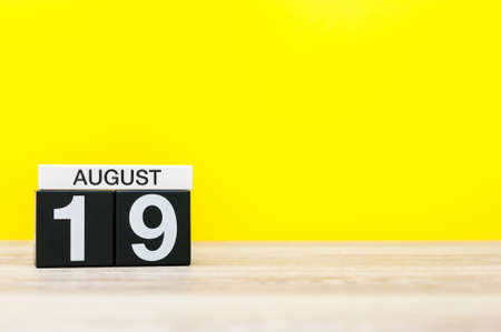 August 19th. Image of august 19, calendar on yellow background with empty space for text. Summer time Stock Photo