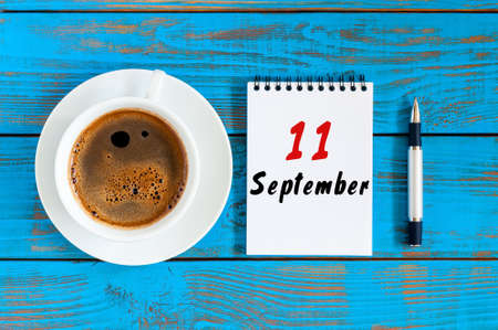 September 11th. Day 11 of month, loose-leaf calendar and morning coffee cup at architect workplace background. Autumn time. Empty space for text