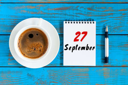 September 27th. Day 27 of month, loose-leaf calendar and coffee cup