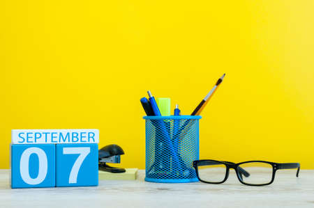 Image of 7th September, calendar on yellow background with office supplies. Fall, autumn time. Stock Photo