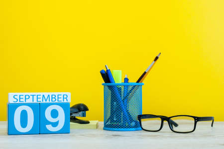 9th September. Image of september 9, calendar on yellow background with office supplies. Fall, autumn time Stock Photo