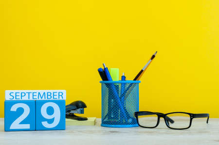 29th September. Image of september 29, calendar on yellow background with office supplies. Fall, autumn time