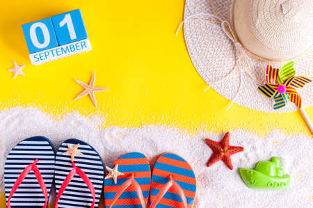 1st September. Image of september 1, calendar on yellow summer background with beach vacation accessories. Back to school concept