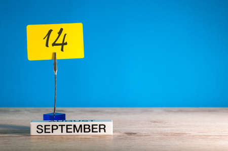 September 14th. Day 14 of month, Calendar on teacher or student, pupil table with empty space for text, copy space