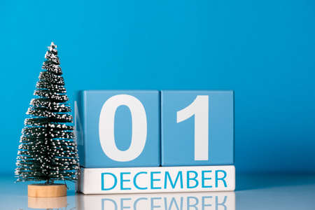 December 1st. Day 1 of december month, calendar with little christmas tree on blue background. Winter time. New year concept Stock Photo