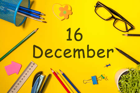 December 16th. Day 16 of december month. Calendar on yellow businessman workplace background. Winter time