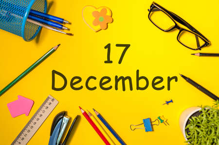 December 17th. Day 17 of december month. Calendar on yellow businessman workplace background. Winter time
