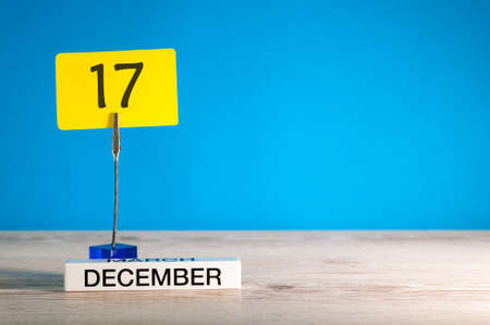 December 17th mockup. Day 17 of december month, calendar on blue background. Winter time. Empty space for text