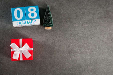 January 8th. Image 8 day of January month, calendar with x-mas gift and christmas tree. New year background with empty space for text, mockup