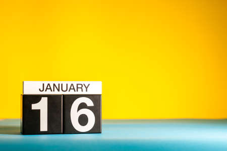 January 16th. Day 16 of january month, calendar on yellow background. Winter time. Empty space for text
